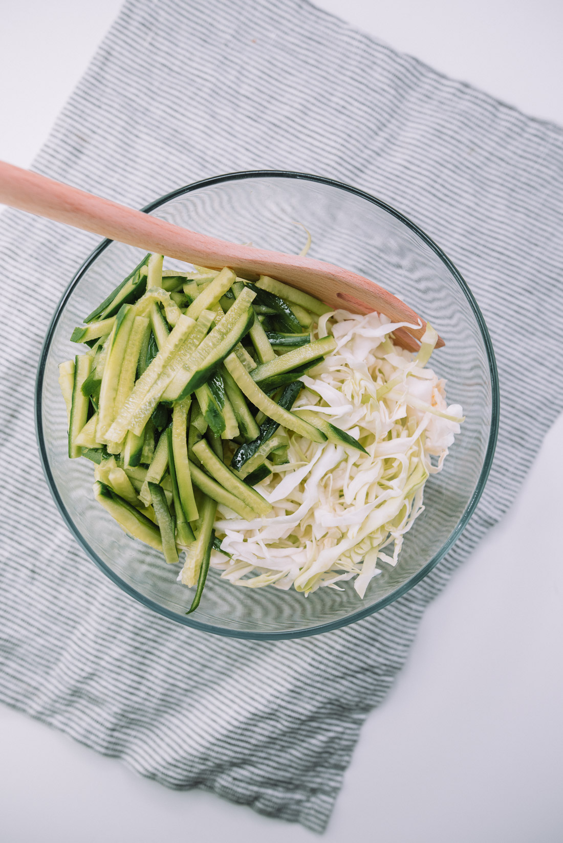 10 ingredient Cucumber Cabbage Slaw is a quick and healthy side dish that pairs with sandwiches, hotdog. Recipe from Mash and Spread.