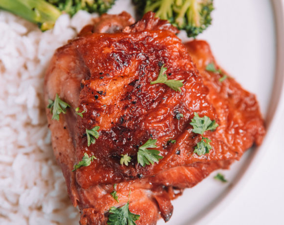 Instant Pot Honey Garlic Chicken with parsley sprinkled on top and a white plate.