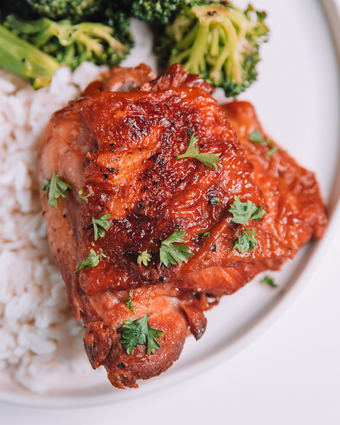 Instant Pot Honey Garlic Chicken on white round plate with a bed of white rice.